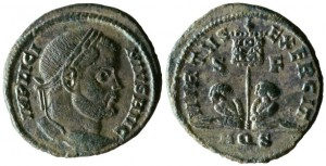 AE of Licinius. Obverse has laureate, draped head right; obverse inscription IMP LICI – NIVS AVG. Reverse has two captives flanking standard bearing legend VOT XX; reverse inscription VIRTVS EXERCIT / S F, AQS in ex. 2.58g, 19mm, 12 o'clock.