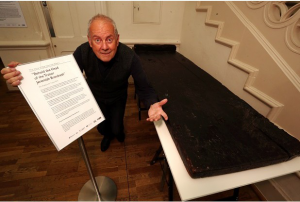 Gyles Brandreth with the execution block and historical interpretation panel