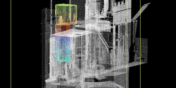 a grey laser scan of a building with a multicoloured section over two floors