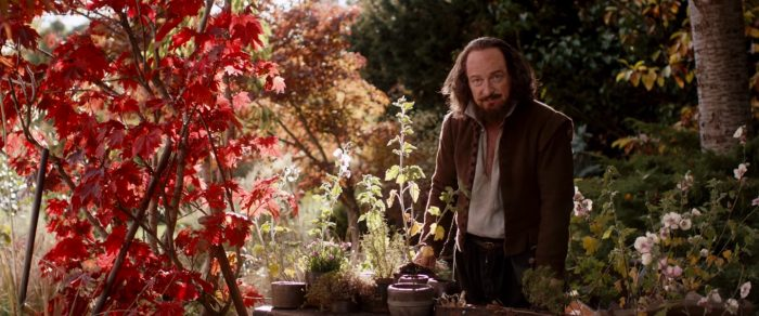 A man stands in a garden.