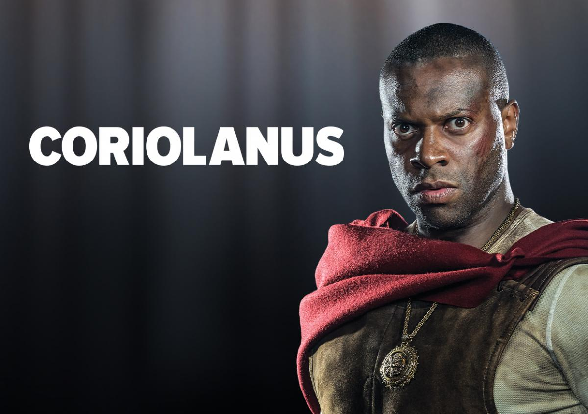 A Black man stands in front of the word Coriolanus