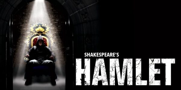 Poster for Hamlet, featuring a man in a hoodie sitting on a throne under a spotlight