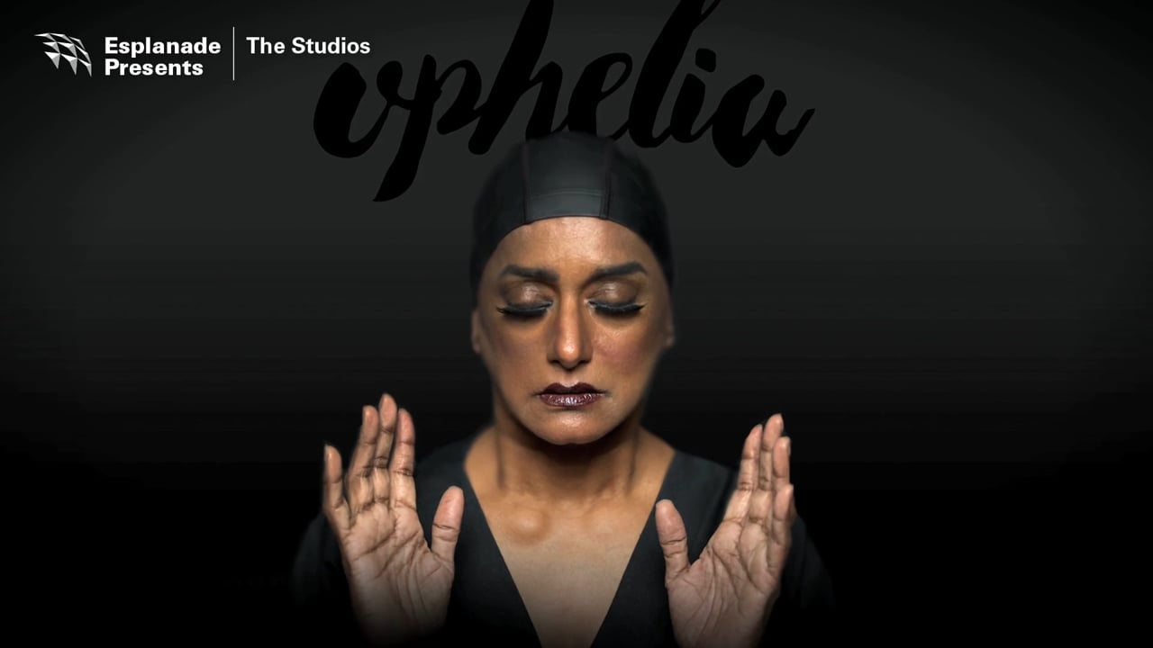 An image of a woman, wearing a swimming cap, holding up her hands with her eyes closed, and the word 'ophelia' above.