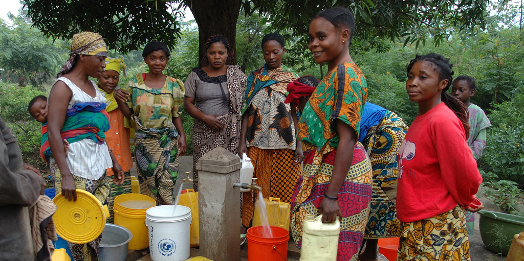 Women at a water standpipe