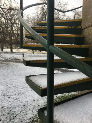 Metal steps covered in snow