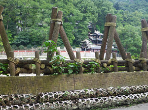 A photograph of bamboo gabions and wooden tripods along the Min River