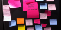 A photograph of 'Bigger picture' uncertainties (written on post-it notes) identified by Blue-Green Cities team at November Uncertainty Workshop