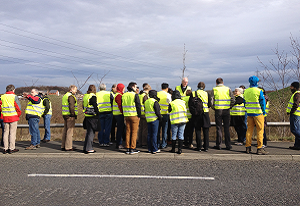 A photograph of the CWFA team at Newcastle Great Park development site, looking at SuDS