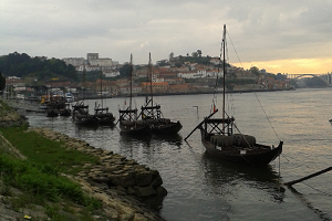 A photograph of port boats on the Douro River.