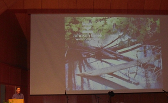 A photograph of Colin Thorne presenting at the Johnson Creek Watershed Council Annual Dinner