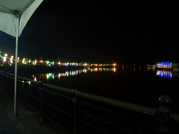 View up the river flowing through Kuching with the government building on the right