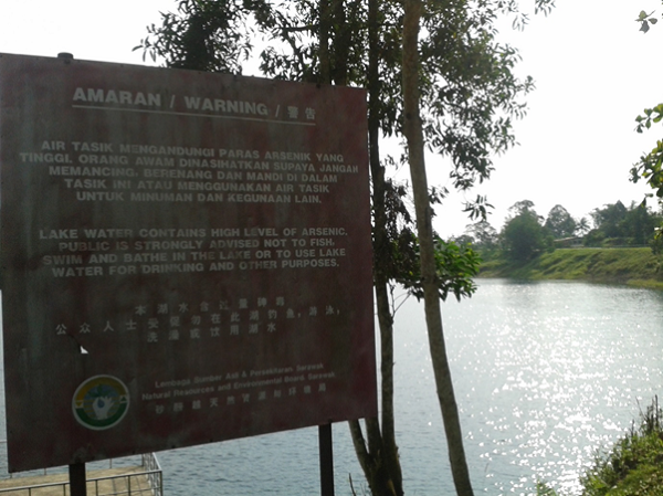 A photograph of a sign depicting some of the water quality issues faced locally in Kuching