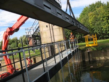 A photograph of  a sluice gate undergoes a major inspection and overhaul.