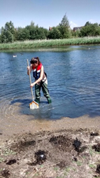 Figure 4. Sara taking samples in the SuDS ponds.