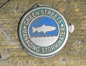 A photograph of a Portland 'Green Streets' logo