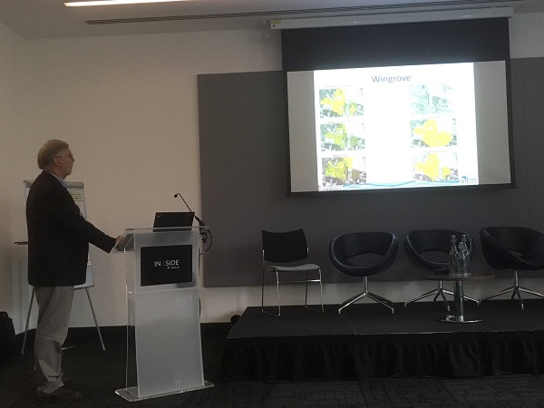 A photograph of Richard Fenner presenting the multiple benefits GIS Toolbox at the Twenty65 conference
