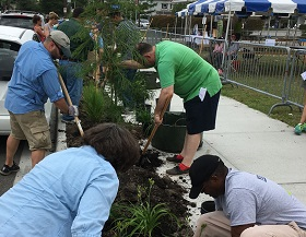 A photograph of the public getting involved in implementing blue-green infrastructure