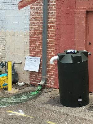 A photograph of a rain barrel (water butt) in Norfolk, USA