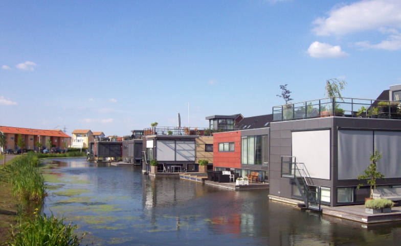 Floating homes in the Netherlands showing resilience towards flooding.