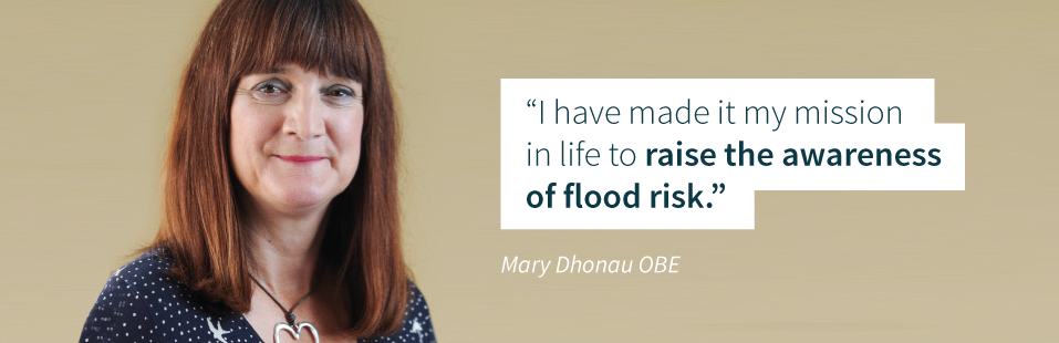 Mary Dhonau OBE with mission statement quote showing commitment to flood relief.