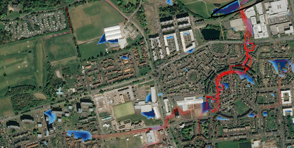Figure 1 CityCat Simulation of the Granton Ponds for a short duration extreme event. Water depths are shown in blue and velocity vectors in red (© Google maps)