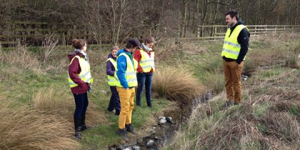 A photograph of the Clean Water for All team discussing SuDS treatment system in Newcastle