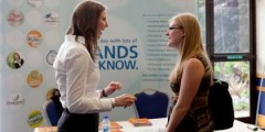 Student talking to employer at a careers event.
