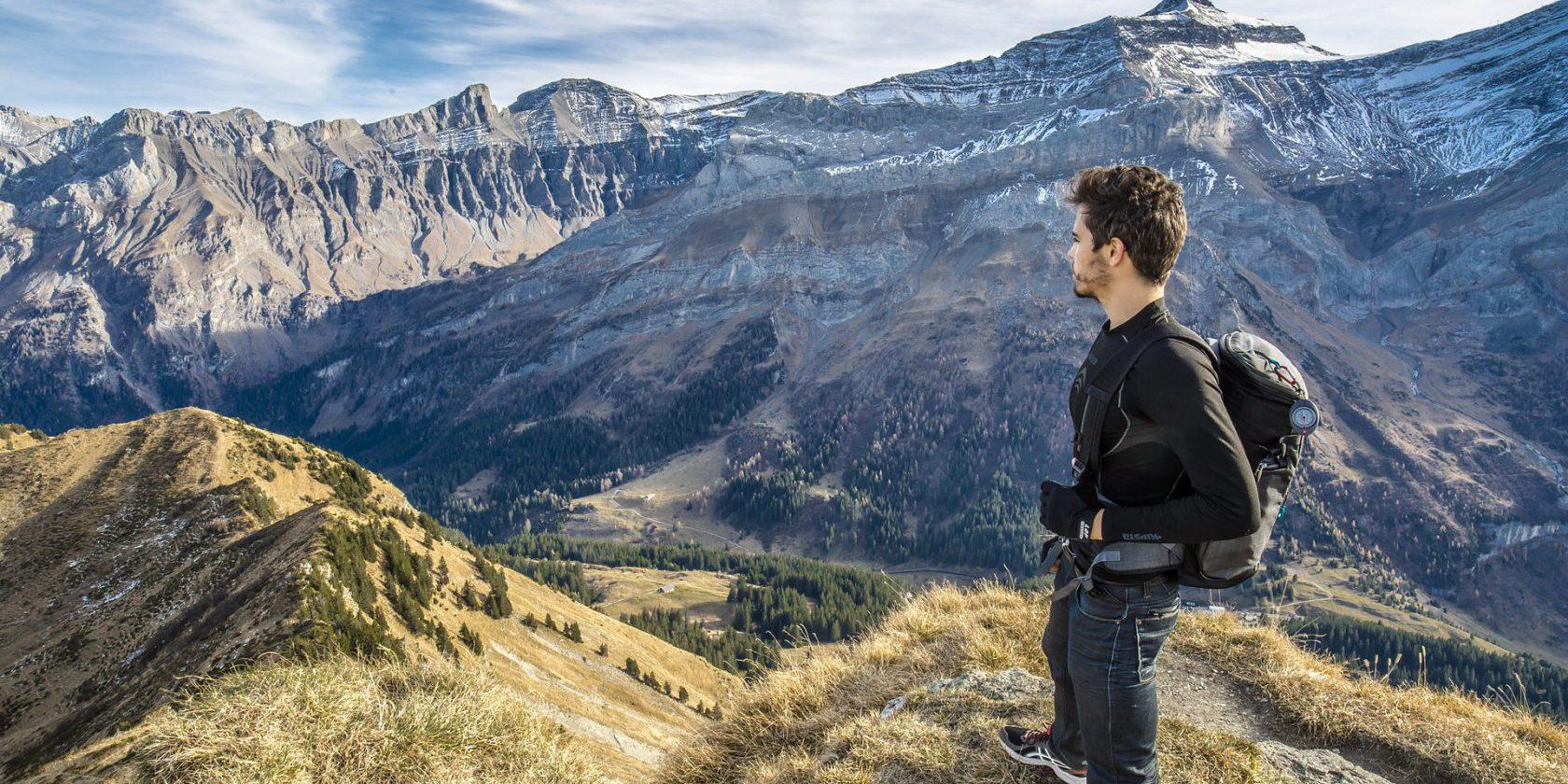 Man standing on mountain, doing international work experience