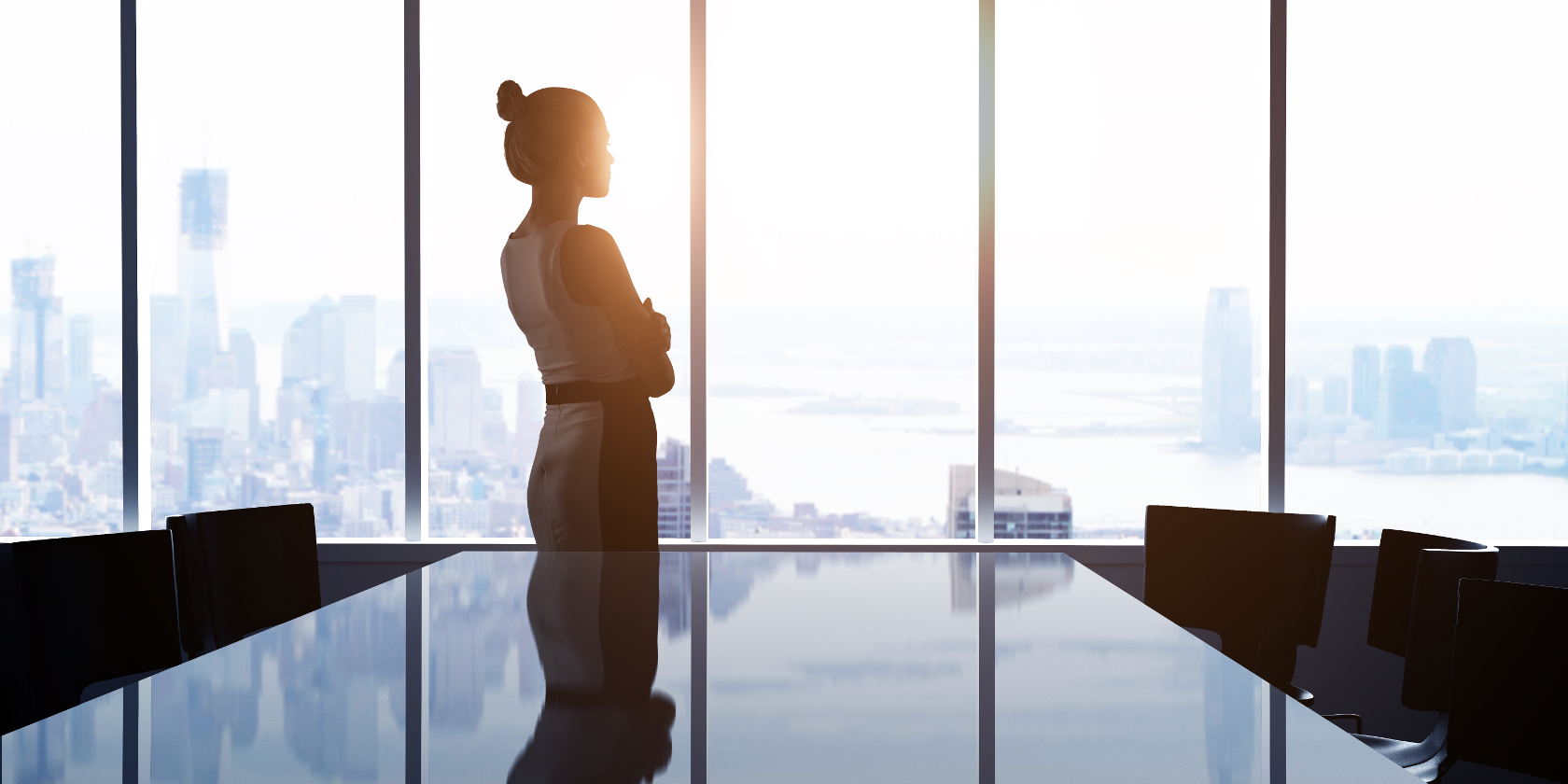 Woman pondering out an office window thinking about alternatives to internships