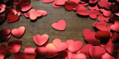 A collection of heart confetti scattered on a table to symbolize valentines day