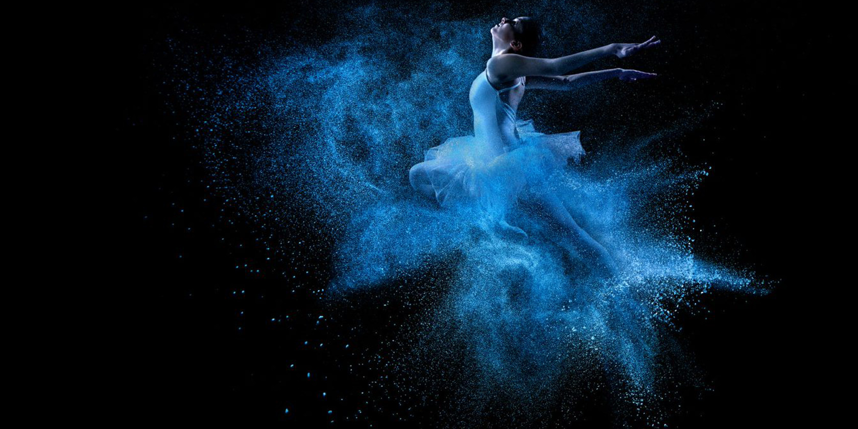 Ballet dancer colour image contrast. Vibrant neon blue colour contrast of ballet clothing onto a black background