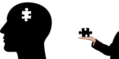 Cartoon image of a professional handing the missing puzzle piece to someone head