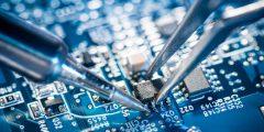 Soldering transistor on circuit board.