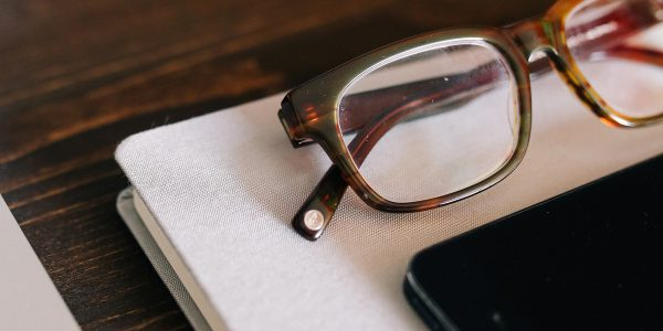 Eyeglasses on Notebook