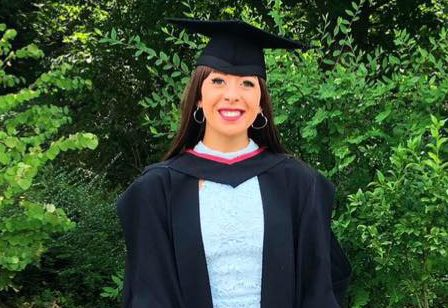 Imogen in graduation gown