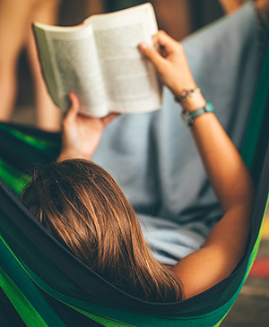 Woman on Hammock Reading Book