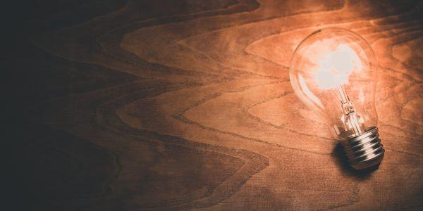 Light Bulb on Wooden Background