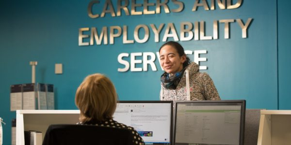 Student talking to the receptionist in the Careers office