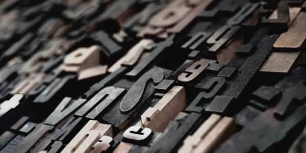 Image shows alphabet printing blocks