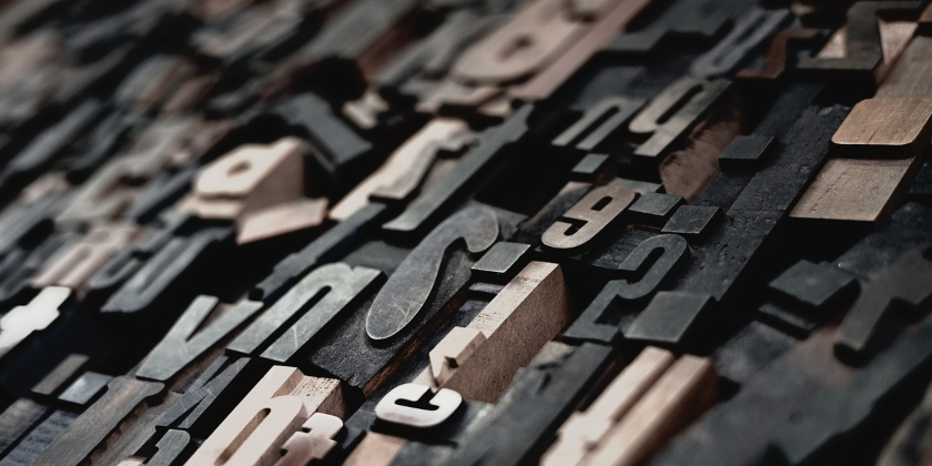 Image shows alphabet printing blocks