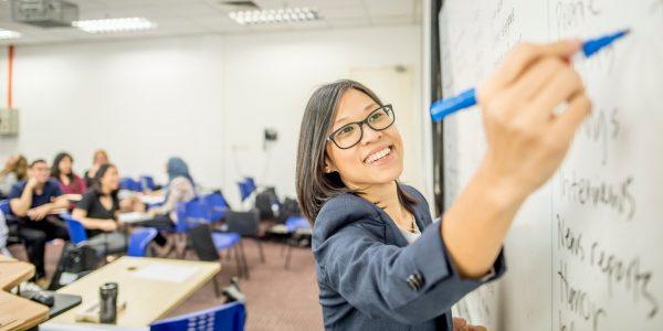 Teacher writing on board