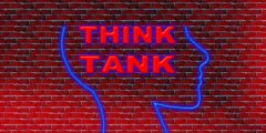 An outline of a head with 'think tank' text inside it