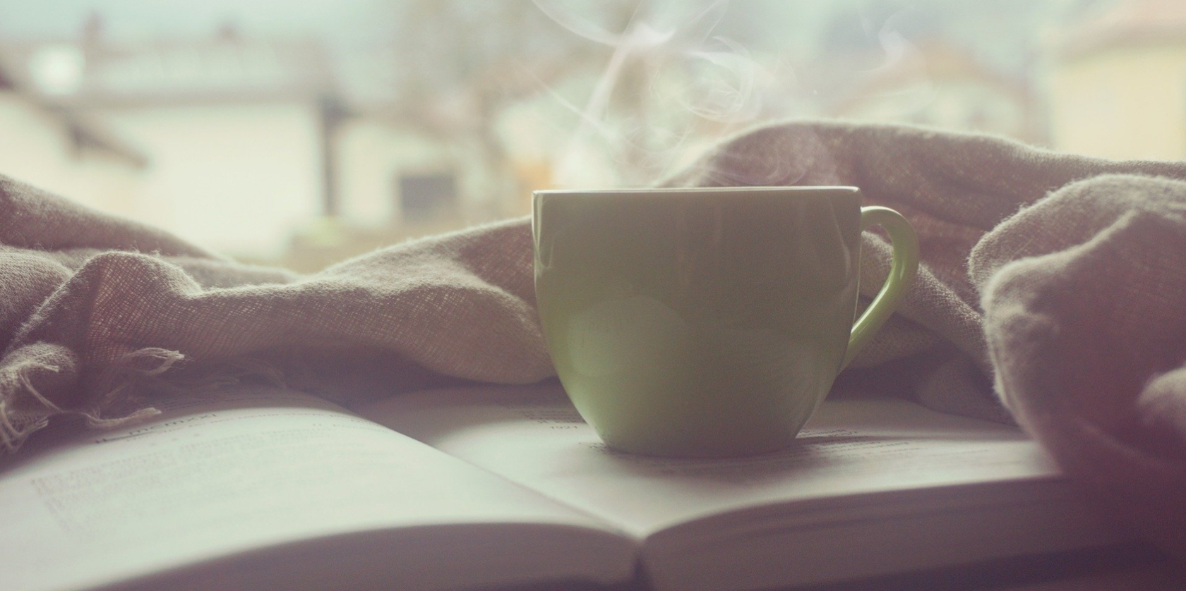 Coffee cup on an open book