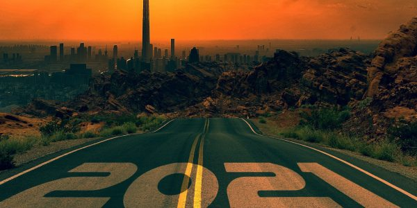 View of a city with 2021 written on the road