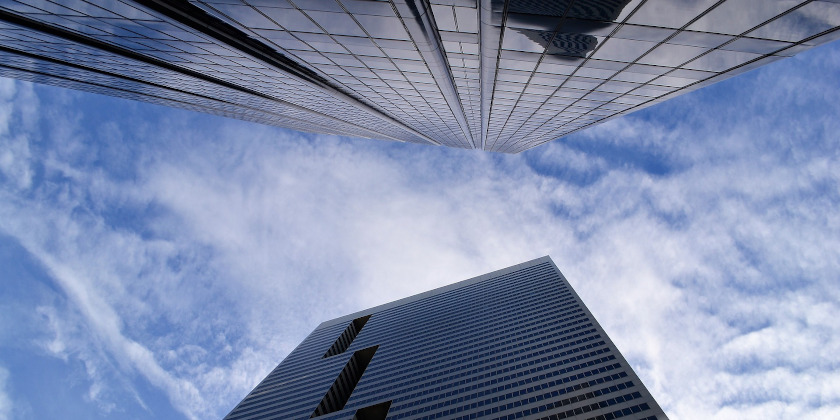 Looking up at two skyscrapers