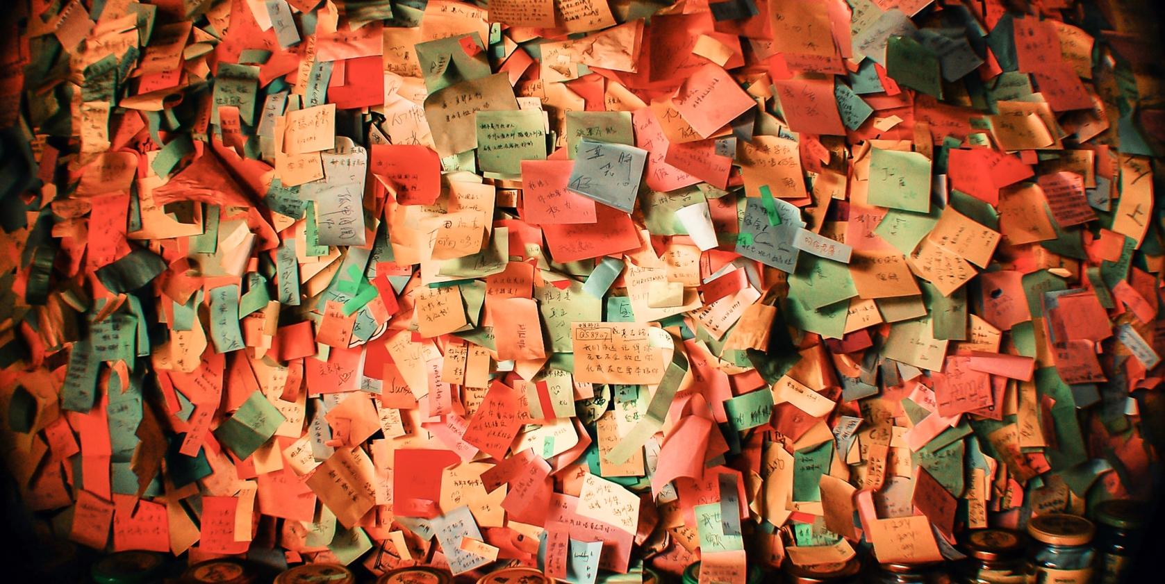 Wall of many, many post its
