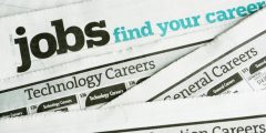 Close up of newspaper with the phrase 'Jobs find your career' across it.