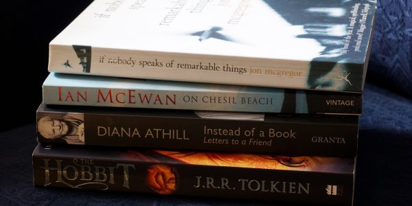 Four books stacked together.