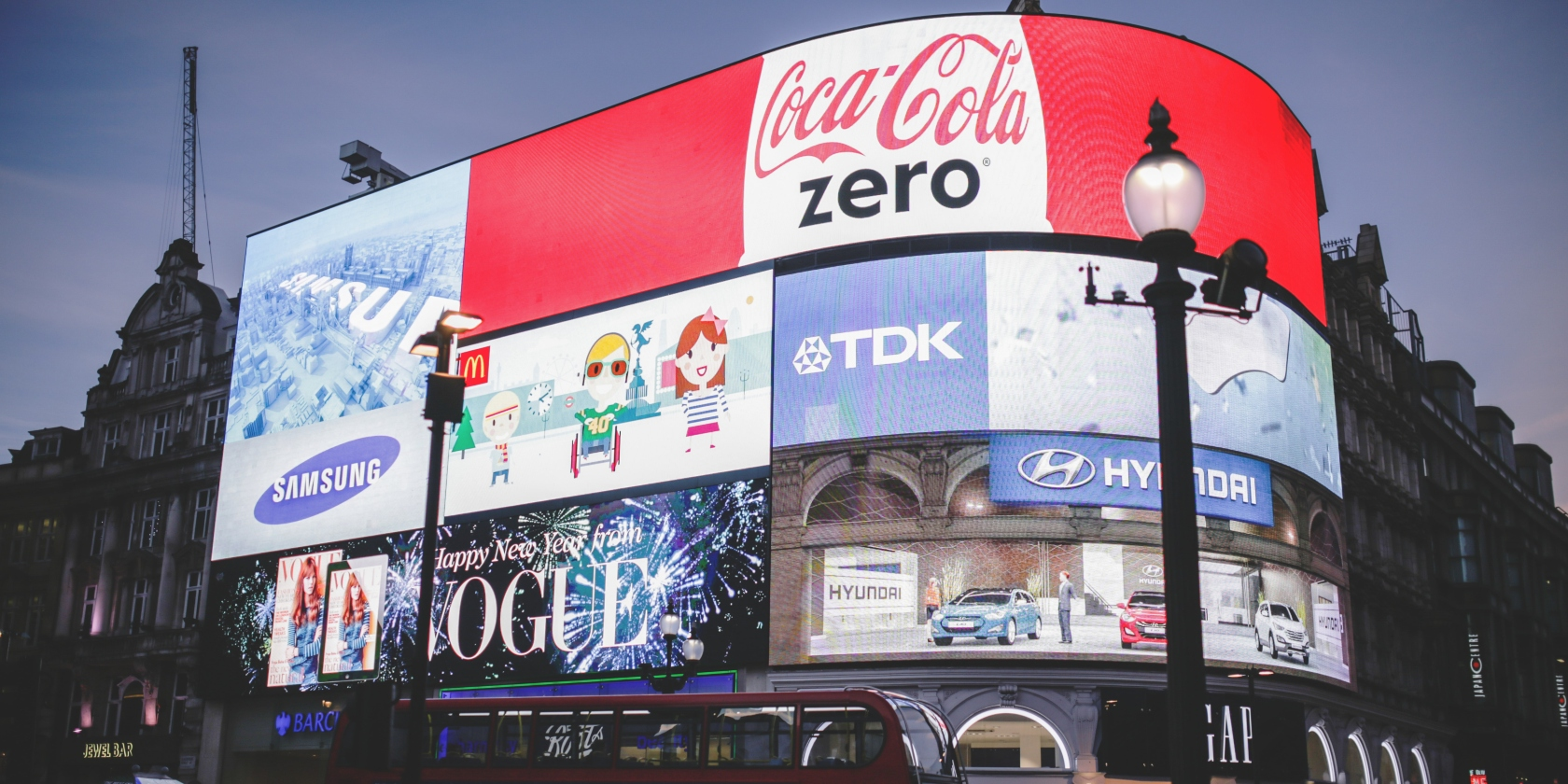 Digital billboards in London showing popular brands such as Coca Cola and TDK.
