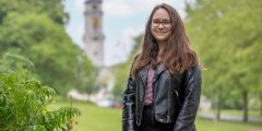 Image of Mila smiling outside of the Trent Building at UoN